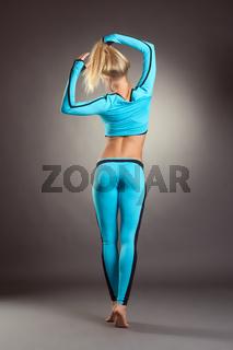 Rear view of slender blonde in sportswear