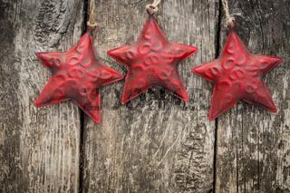 Redd Christmas tree decorations on grunge wood