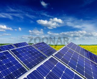Solar battery panels in rural meadow field