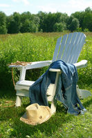 Jeans laying on chair in field
