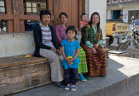 Mothers in national costumes with children,Bhutan