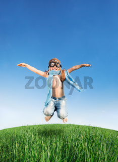Happy kid jumping outdoors