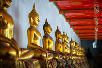 Sculptural images of Buddha in the old temple. Bangkok, Thailand.