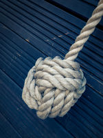 Nautical knot on blue background