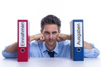 Pensive businessman with folder