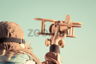 Kid playing with toy airplane