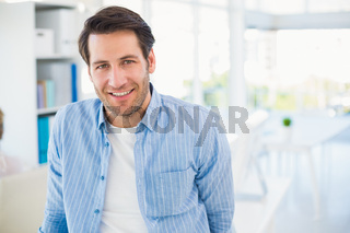Portrait of handsome smiling photo editor