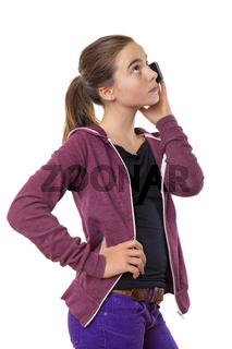 teenage girl speaking on mobile phone, looking into the sky, isolated on white