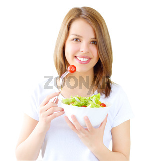 Teenager girl eating salad isolated on white