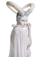 Woman with goat body-art isolated on white