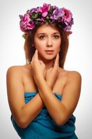 model beautiful woman face close-up head beauty, wreath of flowe