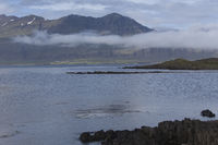 Fog over mountains of Djúpivogur, Iceland