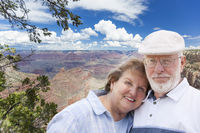 Happy Senior Couple Posing on Edge of The Grand Canyon