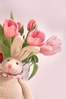 Easter decoration with rabbit and pink tulips