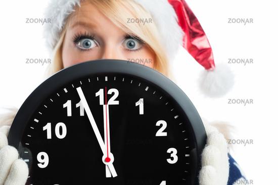 christmas woman holding wall clock