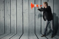Man uses a warning cone as a megaphone