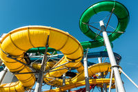 Tube slides at water park against blue sky