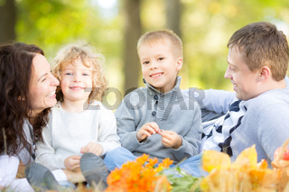 Family having picnic in autumn