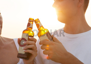 Couple on the beach having party, drinking and having fun