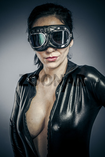 Glamour, Beautiful woman dressed in black latex with glasses aircraft pilot