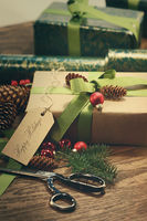 Gifts with tag for the holidays on wood table