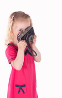 curly-haired little girl with vintage camera isolated