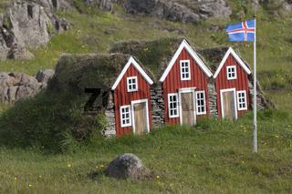 Häuser in Miniatur mit Flagge, Island