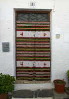 Door with a hand-woven traditional Alpujjaran Rug