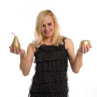 Beautiful woman holding golden fruit in her hands