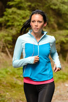 Running woman with headphones outdoor