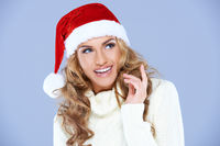 Pretty Happy Woman with Red Santa Hat