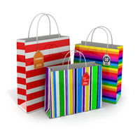 Colourful paper striped shopping bags isolated on white background