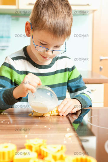 Children baking cookies in the kitchen