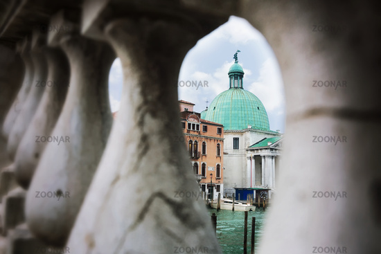 View of one of the churches in Venice over the bridge railing posts