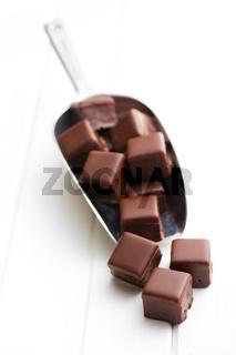 chocolate pralines on metal scoop