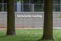 Sign Sächsischer Landtag between trees