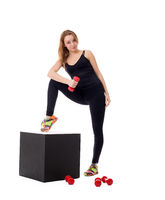 Pretty girl doing pilates exercises at camera