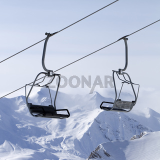 Ropeway at ski resort and mountains in fog
