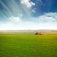 tractor in  field gather crops