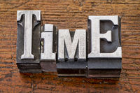 time word in metal type