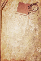 Grunge texture of old book paper sheet and cardboard blank on rope with space for your text