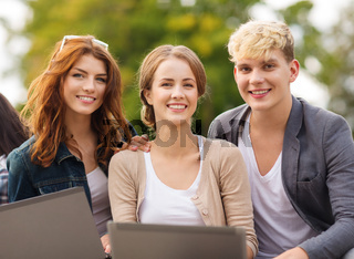 students or teenagers with laptop computers