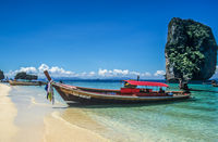Longtail boat on tropical beach