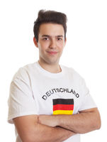 Smiling german sports fan with crossed arms