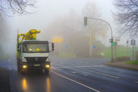 Truck in the morning mist