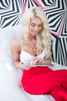 Seductive Young Blond Woman with a tablet