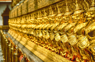 Golden row of Buddhist temple keepers