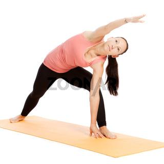 Yoga exercise on the mat, utthita parshva konasana