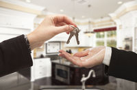 Handing Over New House Keys Inside Beautiful Home