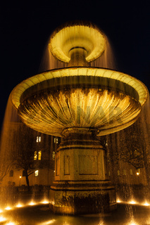 Fountain in the Geschwister-Scholl-Platz in the evening. Munich